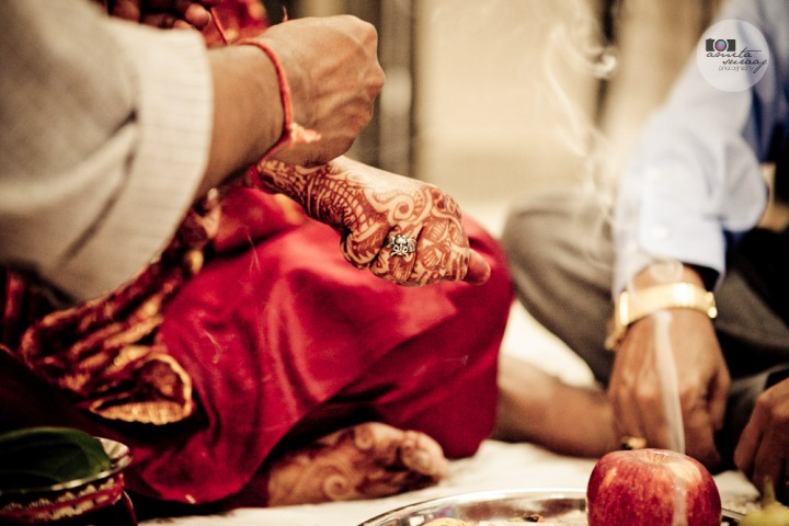 detail of hindu bride at haldi ceremony