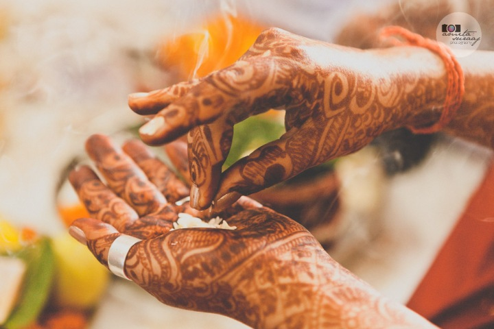 detail of bride's hands from haldi ceremony