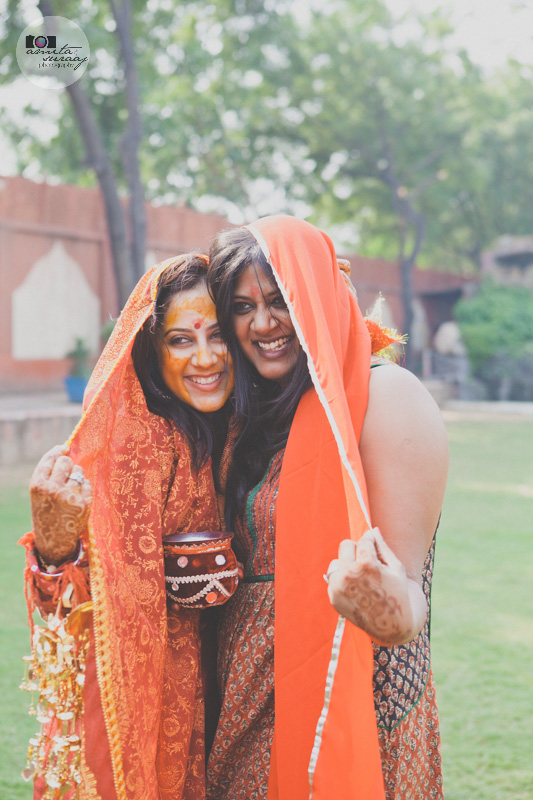 bride and her friend posing for a photograph