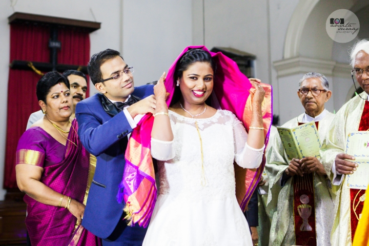 bride and groom at church wedding with saree