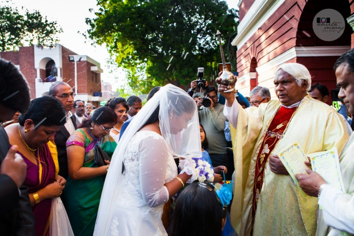 blessings on bride and family at church wedding in delhi