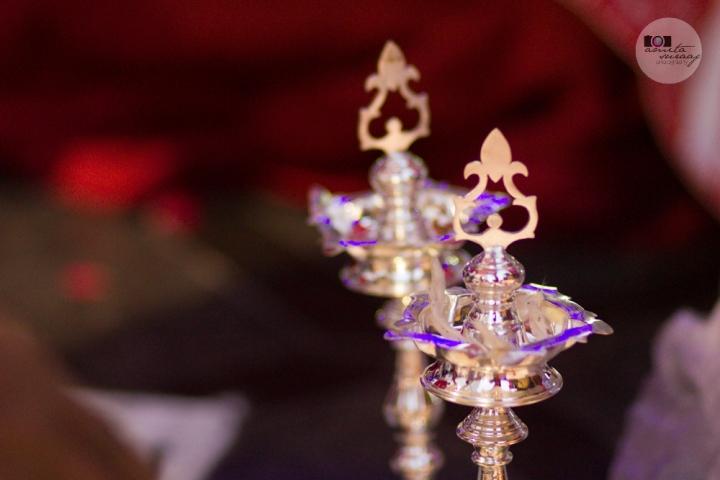 silver lamps at hindu tamil wedding ceremony